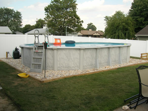 How to landscape around an above ground pool for Above ground pool border ideas